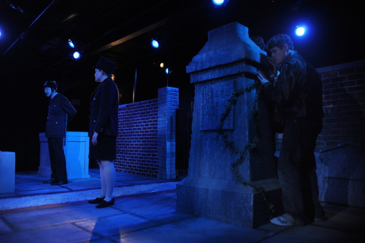 L-R: Officer MacDonald (Terence Gleeson) drills WPC Foster (Kyra Baker) on police procedure, as Joe (Doug Greene) and Brian (Bob Stineman, not pictured) keep out of sight, but are they out of earshot? Set design by Kevin Jordan, lighting by Andrew Cowles, photo by Kyle Cassidy.
