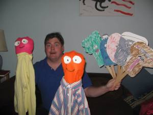 My brother, Ted, with some of the puppets he's made.